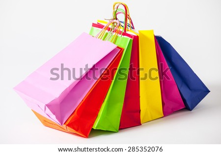 Multicolored paper bags, white background