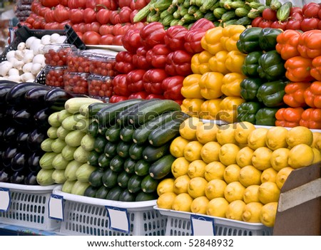 Multicolored particulars vegetables on the grocery market. Multicolored and freshness. - stock photo