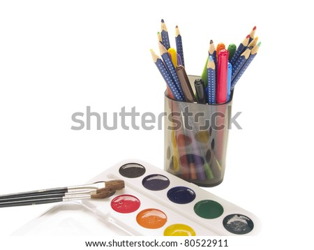 multicolored pencils and watercolors isolated over white background