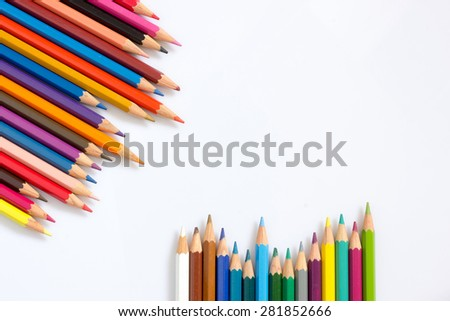 multicolored pencils growing row on white background ,Color pencils Background for business presentation - stock photo
