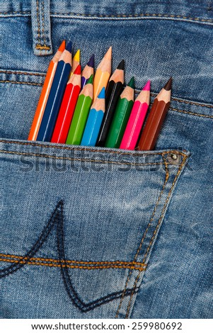 Multicolored pencils in the pocket of jeans  - stock photo