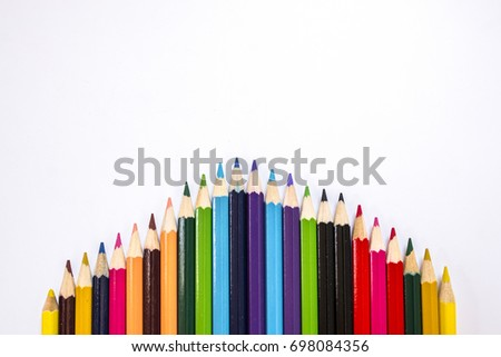 Multicolored pencils isolated on white background. Colorful row curve of colored pencils, Color Pencils, back to school . Colorful wooden pencils