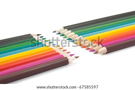 Multicolored pencils on a white background