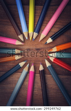 multicolored pencils on the brown wooden table background - stock photo