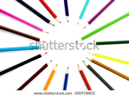 Multicolored pencils on white background to create a collage - stock photo