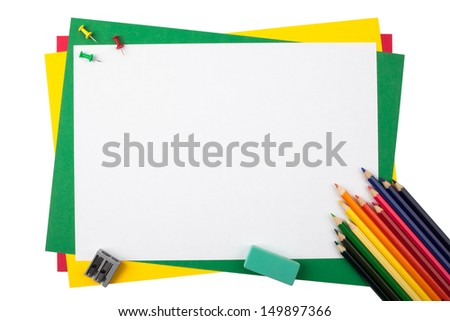 Multicolored pencils, push pins, an eraser and a sharpener on a frame from sheets of colored paper isolated on white background. - stock photo