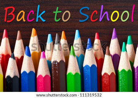 Multicolored pencils with back to school sign - stock photo