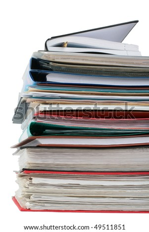 Multicolored pile of binders / files with papers - stock photo