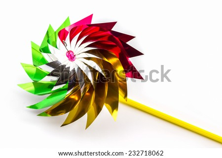 Multicolored pinwheel toy on white background. education, childhood and ecology concept.  - stock photo