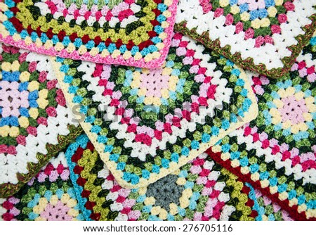 multicolored plaid squares of crocheted - background - stock photo