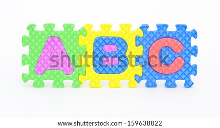 Multicolored plastic toy letters spelling the word Abc isolated on a white background.  - stock photo