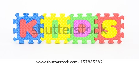 Multicolored plastic toy letters spelling the word Kids isolated on a white background.  - stock photo