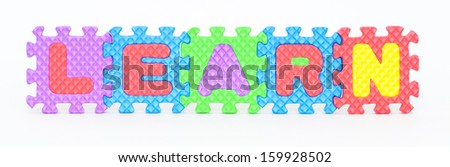 Multicolored plastic toy letters spelling the word Learn isolated on a white background.  - stock photo
