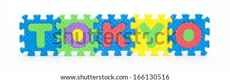 Multicolored plastic toy letters spelling the word Tokyo capital of Japan isolated on a white background.  - stock photo
