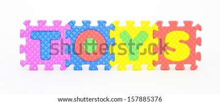 Multicolored plastic toy letters spelling the word Toys isolated on a white background.  - stock photo