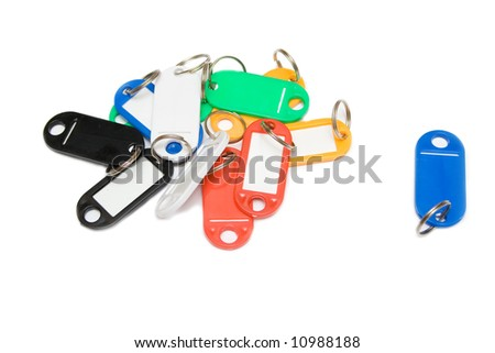 multicolored plastic trinkets on a white background