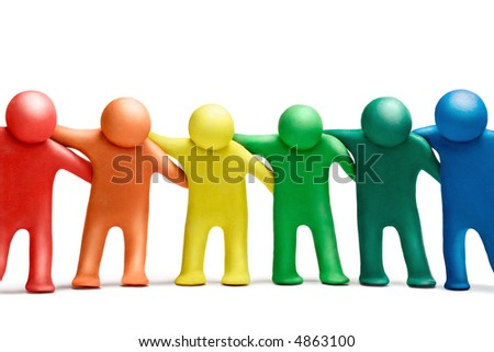 Multicolored  plasticine human dancing figures arranged in a row - stock photo