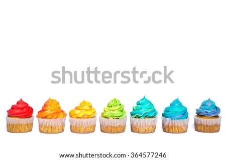 Multicolored rainbow cupcake - stock photo