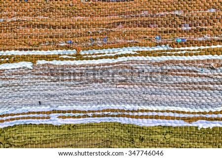 Multicolored rug texture pattern as abstract background. - stock photo