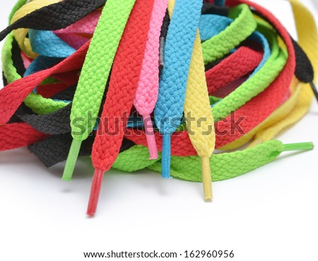 Multicolored shoelaces background - stock photo