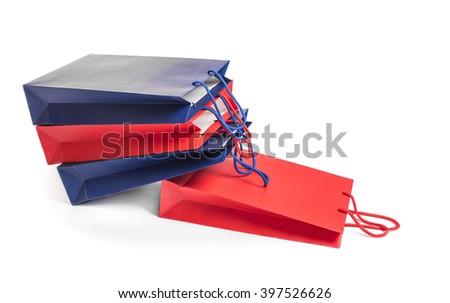 Multicolored shopping bags on a white background. - stock photo