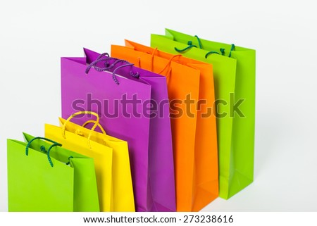 Multicolored shopping paper bags on white background - stock photo