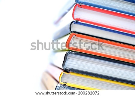 Multicolored stacked books - stock photo
