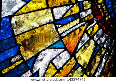 Multicolored stained glass church window, portrait orientation - stock photo