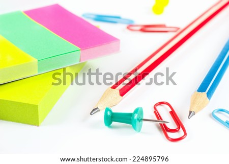 Multicolored stationery on white desktop close up - stock photo