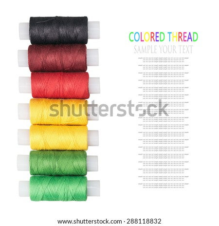 multicolored threads isolated on a white background. for example text and easily removed. focus on bobbins, shallow depth of field - stock photo