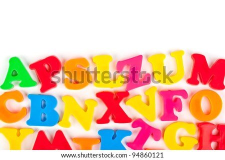 Multicolored toy letters isolated on white background - stock photo