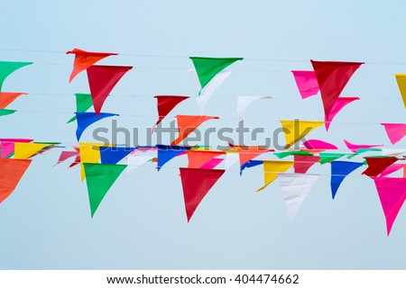 Multicolored Triangular Flags Hanging in the Sky at an Outdoor