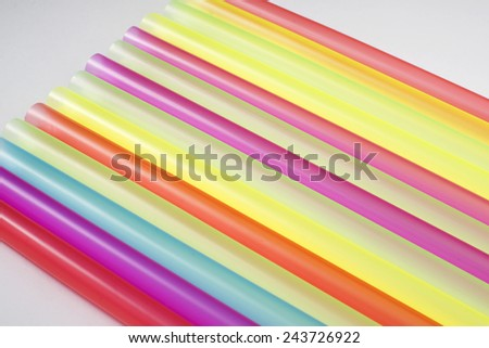 multicolored tubes for drinking on the white background  - stock photo