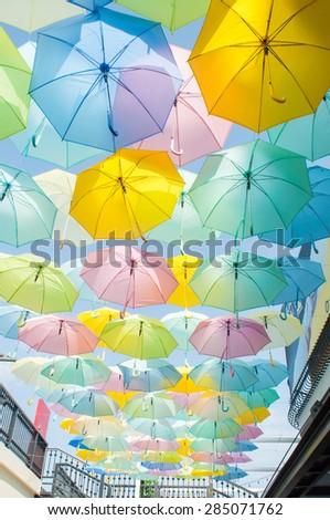 Multicolored umbrella on the walk way, Bangkok Thailand - stock photo