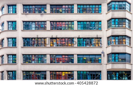 Multicolored windows on a building. Colored reflections from neighbor building./Multicolored windows on a building. - stock photo