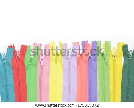 Multicolored zipper lined in a row - stock photo