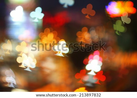 Multicolour bokeh clubs of playing card shape ,the art from night lights - stock photo