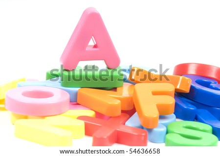 multicoloured bright plastic letters A on white background - stock photo