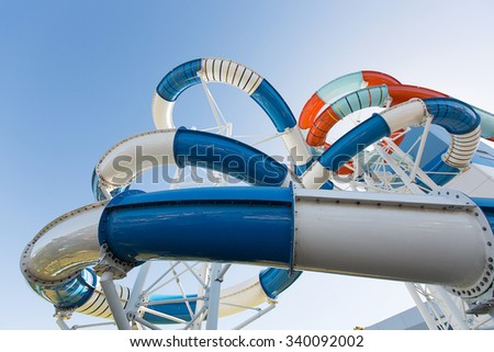 Multicoloured giant water slide at a public swimming pool - stock photo