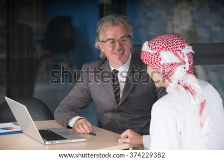 multicultural business partners teamwork at office - stock photo