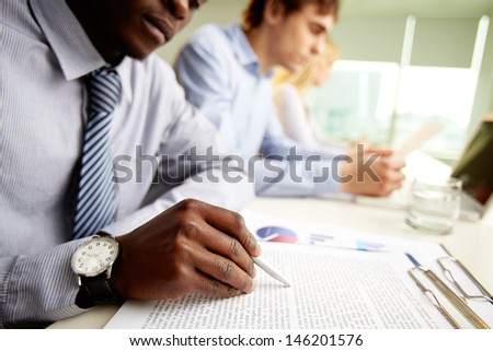 Multicultural business team on their usual working day at office - stock photo