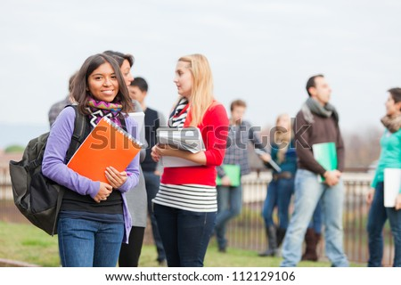 Multicultural College Students at Park - stock photo