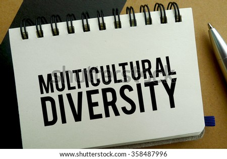 Multicultural diversity memo written on a notebook with pen