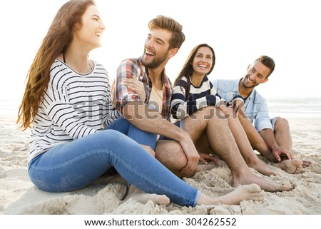 Multicultural group of friends at the beach having fun - stock photo