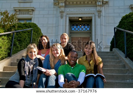 Multicultural students on campus - stock photo