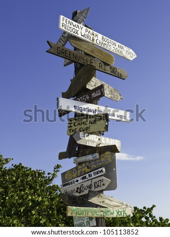 Multidirectional signpost by a beach near Sarasota, Florida - stock photo