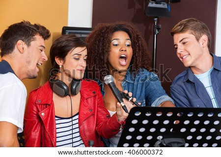 Multiethnic Band Members Performing Together