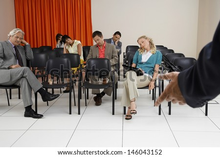 Multiethnic businesspeople sleeping during a seminar in conference room - stock photo