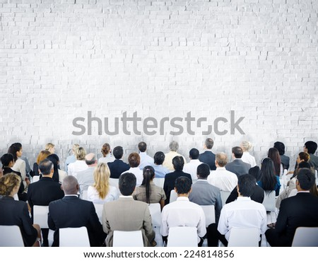 Multiethnic Group of Audiences with Brick Wall - stock photo
