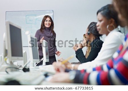 multiethnic group of female customer service representatives in a meeting, adult businesswoman talking. Horizontal shape, side view - stock photo